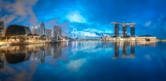 Business district and Marina bay in Singapore. View of business district and Marina bay skyline during sunrise in Singapore stock photography