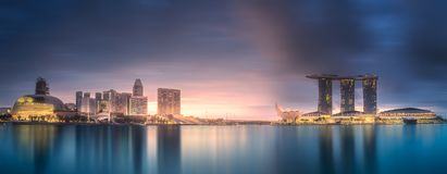 Business district and Marina bay in Singapore. View of business district and Marina bay skyline at sunrise in Singapore. Clipping path of sky royalty free stock photos