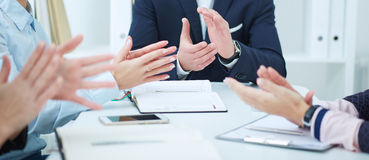 View of the business people clapping in the office. Stock Photography