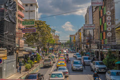 View of business signs and traffic jam during beautiful sunny day in Bangkok Royalty Free Stock Images