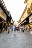 View of the businesses located to the sides of the Bridge on the river Arno, called `Ponte Vecchio` with people walking. Florence, Tuscany, Italy. 22 of May of Stock Photo