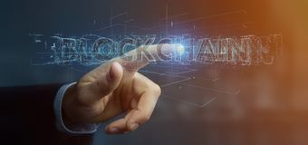 Businessman holding a Blockchain title isolated on a background. View of a Businessman holding a Blockchain title isolated on a background Royalty Free Stock Photo