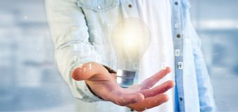 Businessman holding a bulb lamp idea concept with data all around 3d rendering. View of a Businessman holding a bulb lamp idea concept with data all around 3d royalty free stock photo