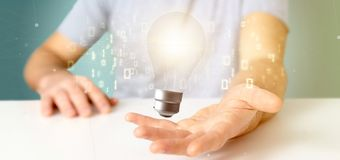 Businessman holding a bulb lamp idea concept with data all around 3d rendering. View of a Businessman holding a bulb lamp idea concept with data all around 3d stock images