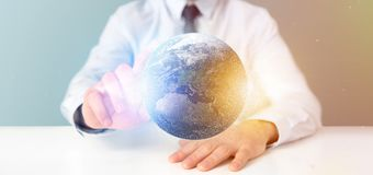 Businessman holding a 3d rendering particles earth globe. View of a Businessman holding a 3d rendering particles earth globe Stock Photography
