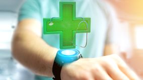 Businessman holding a Lighting pharmacy cross and a stethoscope. View of a Businessman holding a Lighting pharmacy cross and a stethoscope - 3d render Royalty Free Stock Photography