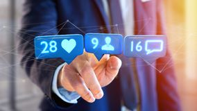 Businessman holding a Like, Follower and message notification on. View of a Businessman holding a Like, Follower and message notification on social network - 3d Stock Images
