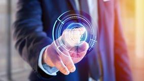 Businessman holding a Shinny technologic globe button - 3d rende. View of a Businessman holding a Shinny technologic globe button - 3d render Stock Photo