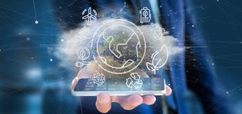 Businessman holding a World globe surronding by ecology icons and connection 3d rendering. View of a Businessman holding a World globe surronding by ecology stock photo