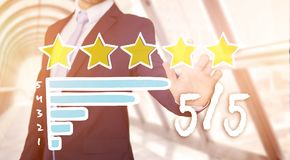 Businessman touching technology interface with ranking stars Stock Photography