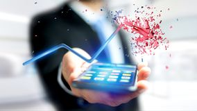Businessman using a smartphone with a  Financial arrow going up. View of a Businessman using a smartphone with a  Financial arrow going up and explosing at the Royalty Free Stock Images