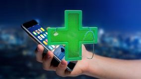 Businessman using a smartphone with a Lighting pharmacy cross an. View of a Businessman using a smartphone with a Lighting pharmacy cross and a stethoscope - 3d Royalty Free Stock Images