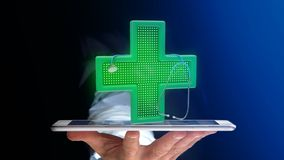 Businessman using a smartphone with a Lighting pharmacy cross an. View of a Businessman using a smartphone with a Lighting pharmacy cross and a stethoscope - 3d Royalty Free Stock Photos