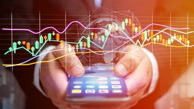 Businessman usng a smartphone with a 3d render Stock exchange tr. View of a Businessman usng a smartphone with a 3d render Stock exchange trading data Stock Photos