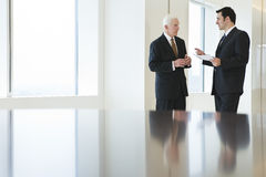 View of businesspeople discussing in an office. Stock Photography