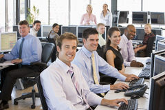 View Of Busy Stock Traders Office. Smiling To Camera Royalty Free Stock Photography