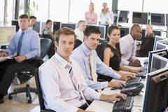 View Of Busy Stock Traders Office. With Traders Looking At The Camera Royalty Free Stock Images