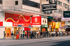 View of busy street and shops of Hong Kong Stock Photos