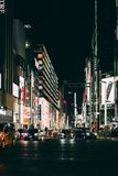 View of the busy streets of Ginza in Tokyo ar night with intent. TOKYO, JAPAN - MAY 17, 2018: View of the busy streets of Ginza in Tokyo ar night with royalty free stock photography