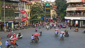 View of busy traffic in an intersection with many motorbikes and vehicles in Hanoi, capital of Vietnam. Hanoi,Vietnam - January 25,2018 : View of busy traffic stock video footage