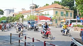 View of busy traffic in an intersection with many motorbikes and vehicles in Hanoi, capital of Vietnam. Hanoi,Vietnam - May 25,2018 : View of busy traffic in an stock footage