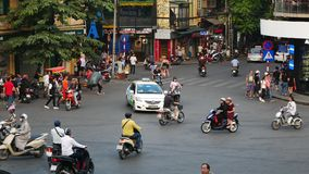 View of busy traffic in an intersection with many motorbikes and vehicles in Hanoi, capital of Vietnam. Hanoi,Vietnam - November 15,2017 : View of busy traffic stock footage