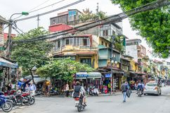 View of busy traffic in an intersection with many motorbikes and vehicles in Hanoi Old Quarter, capital of Vietnam. Royalty Free Stock Images