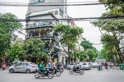View of busy traffic with motorbikes and vehicles in Hanoi Old Quarter, capital of Vietnam. Royalty Free Stock Images
