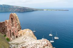 Byzantine castle ruins and Aegean Sea in Oia, Santorini. View of Byzantine castle ruins and Aegean Sea in Oia, Santorini, Greece royalty free stock photo