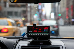 View from cab with meter display. NEW YORK - FEBRUARY 16:  View from cab with meter display in New York on February 16, 2015 Royalty Free Stock Image