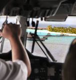 View from a cabin of the flying airplane on the tropical island Stock Photo