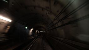 Moving in the subway tunnel. View from the cabin of metro train moving in the subway tunnel stock footage