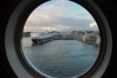 The view from the cabin through the porthole of the tourist ferry. The view from the cabin through the porthole of the tourist ferries, ships, cruise, travel Royalty Free Stock Images