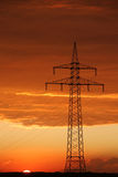 View of cables on pylon. Shot of an electricity pylon, with cables hung on it Stock Photo