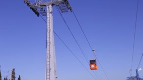 View of cableway gondola cable car on blue sky background stock video