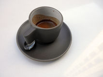 View of Cafe cup of espresso on plate with spoon Stock Images