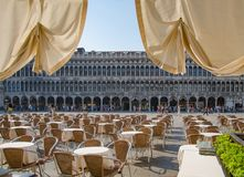 View from the cafe on the Procuratie Vecchie, located on the Piazza San Marco, tourists are sightseeing stock images
