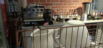 View of the cafe rack with equipment and utensils, public cafe. royalty free stock photo