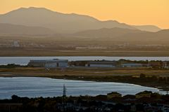 View of Cagliari with landing track of the airport, mountains,  sea at sunset Stock Images