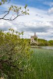 A view of Cahermacrea Castle from across the lake in front of the castle, this can be seen on the Dromore Reserve Wood Walk in. County Clare, Ireland, nobody in royalty free stock image