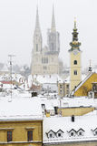A view of the cahtedral of zagreb, Croatia, and roofs covered in. Snow Royalty Free Stock Photo