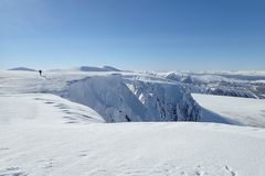 View from Cairn Lochan, Cairngorms, Highlands, Scotland. A bright winter day view from Cairn Lochan, Cairngorms, Highlands, Scotland, UK. Cornices over the Vent Royalty Free Stock Photos