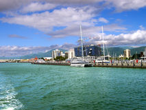 View of Cairns, Australia from the water. View of the waterfront of Cairns, Australia under blue sky and clouds from the water Stock Image
