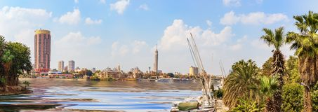 View on Cairo downtown with the Tower and fashionable hotels in the harbour of the Nile,  Egypt. Africa arabian architecture blue boat bridge building business stock photography