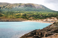 View of Cala Mesquida with sand beach, Mallorca. Cute bay of Majorca island. View of Cala Mesquida with sand beach and azure turquoise sea from cape of Sa Stock Photos