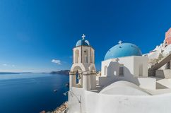 View of caldera with classical blue church domes Stock Image