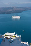 View from Caldera cliff at cruisers and volcanic island, Fira, Santorini. Greece Stock Photo