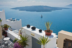 View from Caldera cliff at cruisers and volcanic island, Santorini. Greece Stock Photo