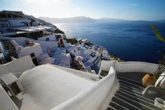 View on the Caldera of Santorini with a back light on the sea stock image