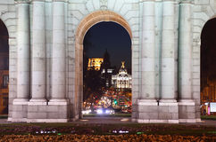 View of Calle de Alcala street through Arch Puerta de Alcala Royalty Free Stock Image